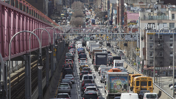 Traffic makes its way into Manhattan over the Williamsburg Bridge in March 2019. New checkpoints at New York City's major bridges, tunnels and other sites are meant to drive home the message that 14-day quarantine rules are mandatory for people returning from states considered coronavirus hot spots.