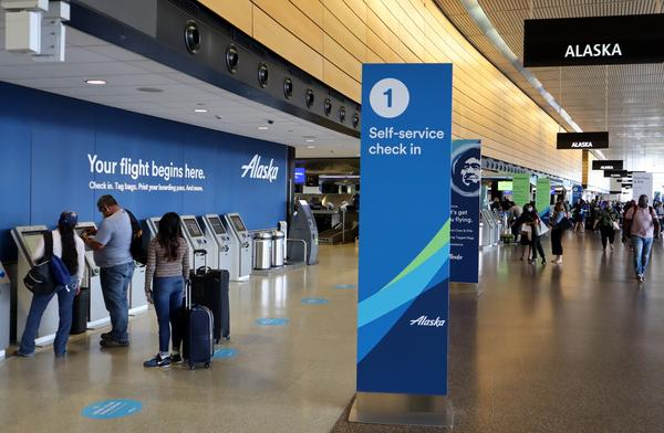Departing passengers at Sea-Tac International Airport have lots of check-in kiosks to choose from with air traffic still way down from last year.