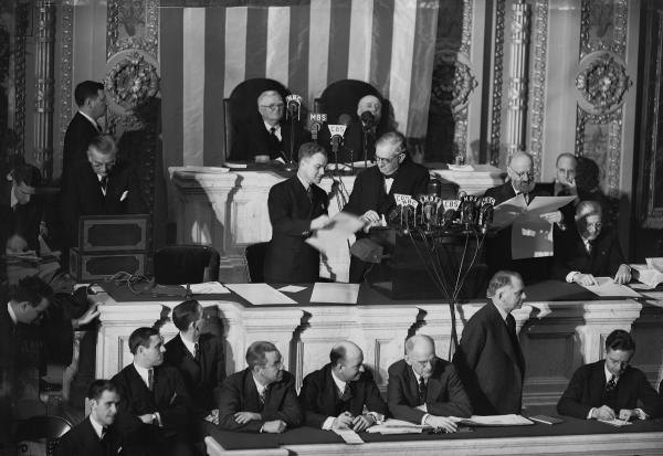 Col. Edwin A. Halsey, far left, secretary of the Senate, takes electoral ballots out of a box as a clerk , center hands them to Sen. Tom Connally, D-Texas, as a joint session counts electoral votes for the November presidential election at the Capitol in Washington, D.C., Jan. 6, 1941. (AP Photo)