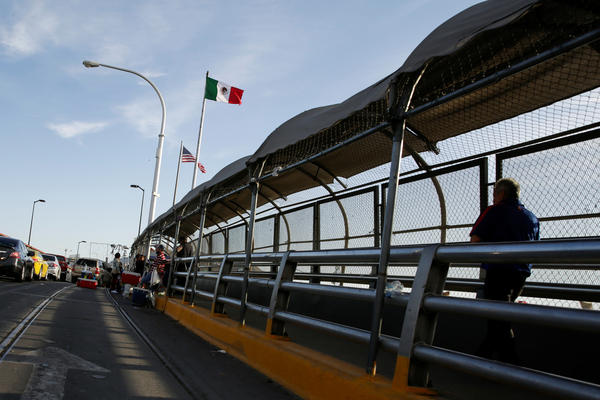 A man crosses the Paso del Norte border bridge toward El Paso, Texas, as seen from Ciudad Juárez, Mexico, on July 1. Since March, U.S. immigration officials have turned away tens of thousands of migrants, including asylum-seekers and unaccompanied children.