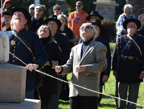 Norm Kelly, center, participates in the unveiling and dedication of a fully restored Civil War monument, 'The Shaft,' in October at Peoria's Springdale Cemetery.