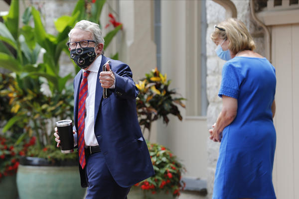 Ohio Governor Mike DeWine, left, and his wife Fran, walk into the governor's residence after he tested positive for COVID-19 earlier in the day Thursday, Aug. 6, 2020, in Bexley, Ohio.