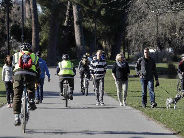 Residents exercise Sunday at Hagley Park in Christchurch, New Zealand. The country's border remains closed to foreign nationals, and New Zealanders returning home are forced to follow a strict 14-day quarantine.