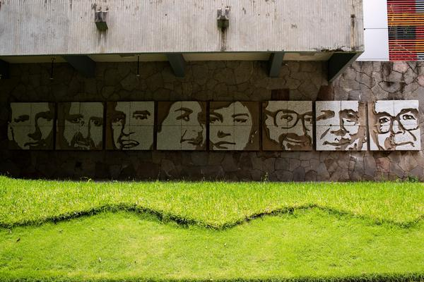 A mural made by artist Josué Villalta on the wall of a building of the José Simeón Cañas Central American University showing the faces of Jesuit priests who were executed by members of the Salvadoran army in 1989.