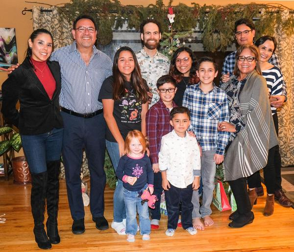 HOPE SHATTERED Carlos Henriquez, second from left, with his daughter Monica, far left, his son Carlos, back far right, wife Patricia, front, second from right, and grandchildren and in-laws in California during the holidays last year.