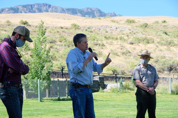 Sen. Steve Daines (R-MT) makes an address Aug. 11, 2020 about the recently passed Great American Outdoors Act as Yellowstone National Park Superintendent Cam Sholly looks on.