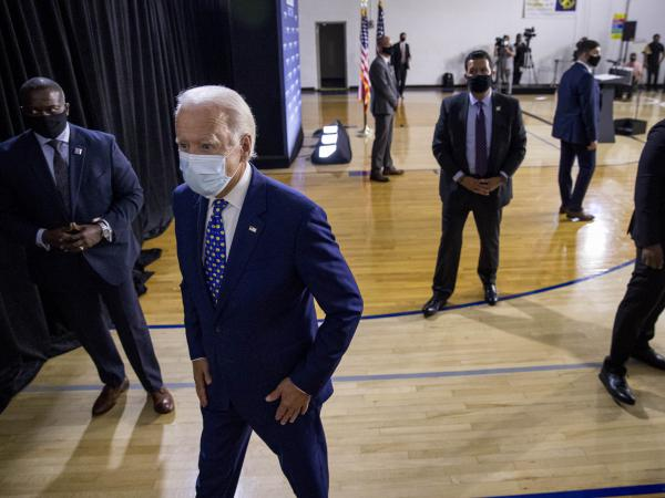 Former Vice President Joe Biden leaves a campaign event last month in Wilmington, Del. If Biden wins the election, he may face political pressure over what to do about President Trump.