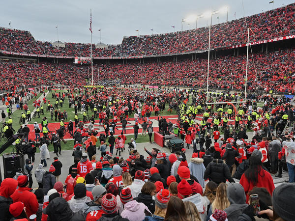Fans rush the field after the Ohio State Buckeyes defeat the Penn State Nittany Lions 28-17 in November in Columbus, Ohio. The Big Ten and PAC-12 have put fall sports on hold due to the pandemic.