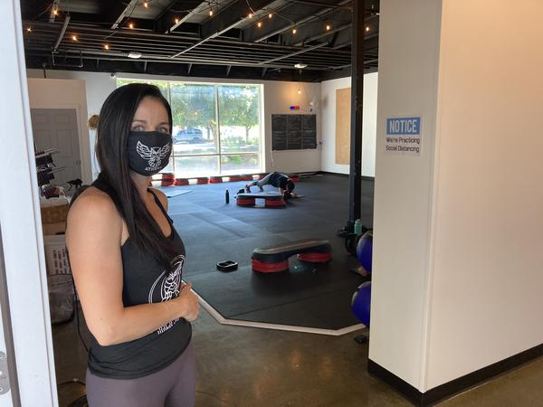 Tiffany Krueger, owner of Athena Fitness and Wellness in Olympia, says the governor's new 17-foot distancing rule for fitness clubs is unfair and could put her out of business.