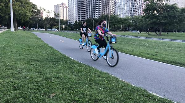 Cyclists enjoy a ride on Chicago's Lakefront Trail on a recent evening. Biking there and all across the country is up significantly during the pandemic.