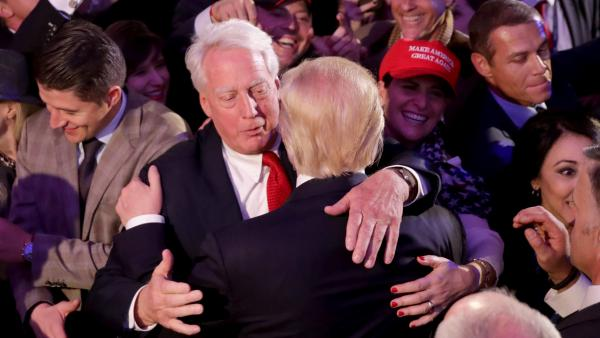 Donald Trump, then the president-elect, hugs his brother, Robert Trump, after delivering his acceptance speech at the New York Hilton Midtown in the early morning hours of Nov. 9, 2016, in New York City.