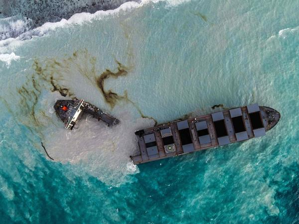 An aerial picture taken on Sunday shows the MV Wakashio bulk carrier that had run aground and broke into two parts near Blue Bay Marine Park, Mauritius.
