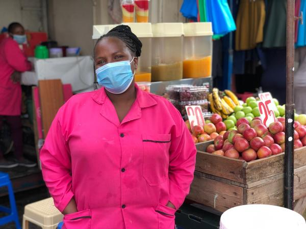 Monica Muthuma has been selling fruits, vegetables and dawa for five years at this stand. Since the pandemic began peaking in Kenya, she says, her ginger-infused drink has taken center stage at her store.