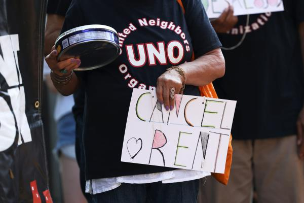 NEW YORK, NEW YORK - AUGUST 10: A demonstrator holds a sign as she listens to speakers during a 'Resist Evictions' rally to protest evictions on August 10, 2020 in New York City. The Right to Counsel NYC Coalition organized a day of action across New York City for tenants who are struggling to pay rent due to the COVID-19 public health crisis. Gov. Andrew Cuomo extended the eviction moratorium which ended on August 6, for an extra 30 days. (Photo by Michael M. Santiago/Getty Images)