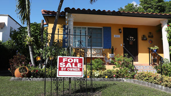 A sale sign is seen in front of a home in Miami. FHA loans are used by many minority, lower-income, and first-time homebuyers because the low down payments make homeownership more affordable. But this demographic is more likely to be hurt financially during the pandemic, and many FHA borrowers are skipping mortgage payments.