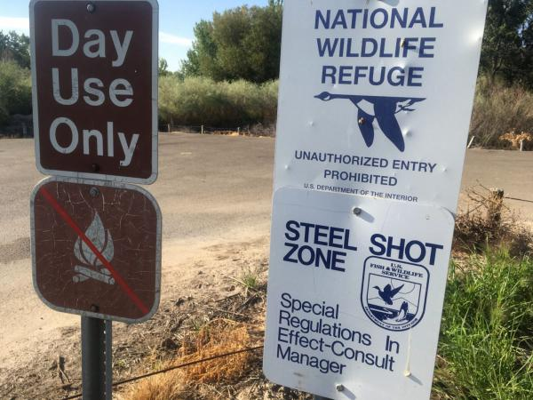 These signs at Deer Flat Wildlife Refuge in Nampa, Idaho, highlight federal regulations that already require hunters to use non-lead ammunition when hunting waterfowl to avoid contaminating waterways.