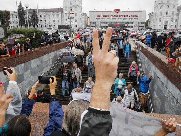 Protesters gather in front of the Minsk Tractor Works Plant to support workers leaving the plant after their work shift in Minsk, Belarus, on Wednesday.