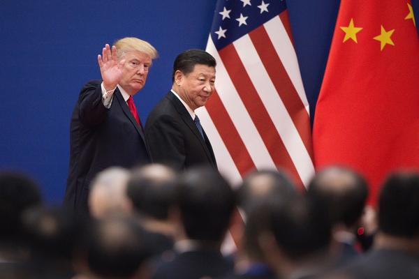 President Donald Trump (L) and China's President Xi Jinping leave a business leaders event at the Great Hall of the People in Beijing on November 9, 2017. (NICOLAS ASFOURI/AFP via Getty Images)