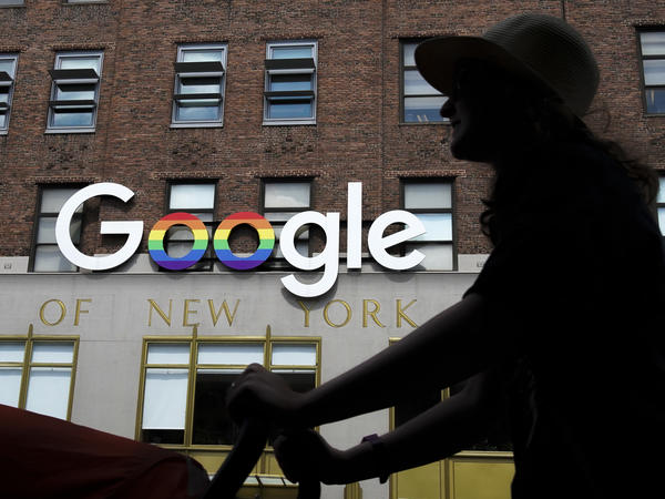 The Google logo adorns the outside of the company's New York City office building. The stock market is hitting records, in large part because of a handful of superstar tech stocks, including Alphabet, Google's parent company.