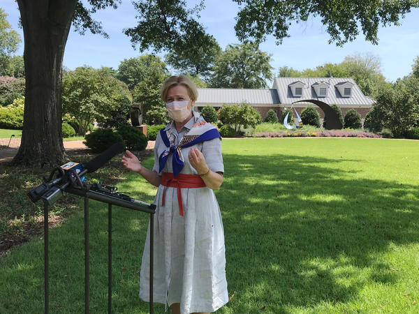 "Dr. Deborah Birx speaks to reporters this week outside the Arkansas Governor's Mansion in Little Rock. Birx indicated that data on U.S. COVID-19 hospitalizations will move back to the CDC under a ""revolutionary new data system"" the agency is developing."