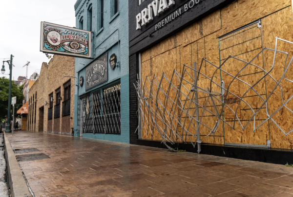 Workers boarded up bars along Sixth Street after they were ordered closed by Gov. Greg Abbott for the second time during the pandemic.