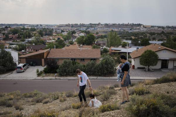 Dr. Chris Hoover (left) and Dr. Connie Liu (right) walk through their home with their children Taro, 3, and Hiro, 4 months, in Gallup, N.M. On a short reporting trip across the Southwest, NPR met very different families and asked them the same simple question: What's been keeping you up at night?