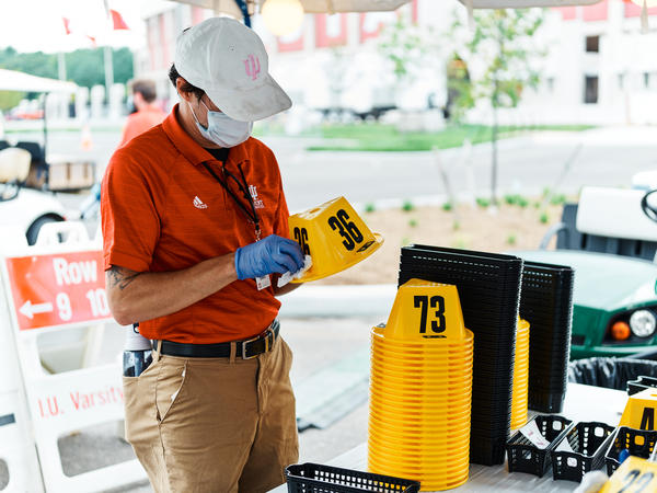 Worker stands at a COVID-19 testing center at IU Bloomington on Sunday, Aug. 9, 2020.