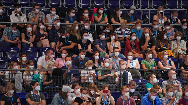 Participants wearing face masks in Leipzig, Germany, take part Saturday in a study to test how the coronavirus might spread in concert settings.