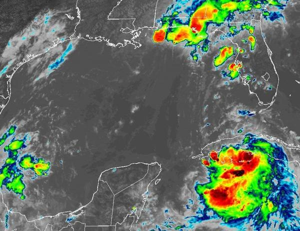 Tropical Storm Marco (upper right) and Tropical Storm Laura (lower right). The warm Gulf waters promise to intensify Laura into a hurricane.
