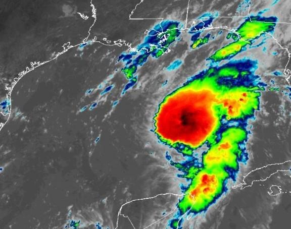 Hurricane Marco weakened to a tropical storm Sunday night.