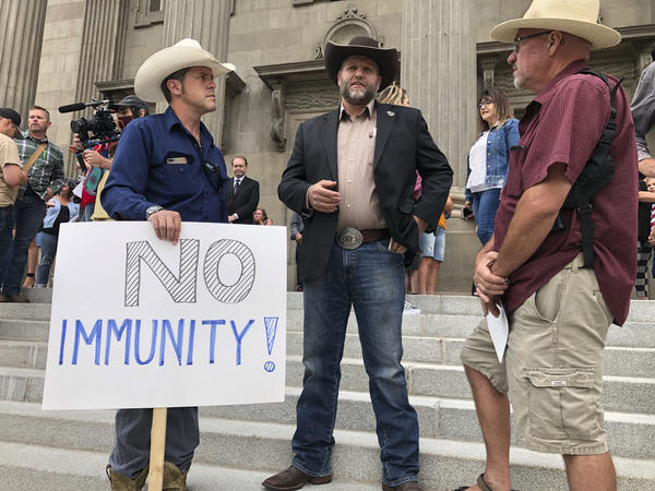 Ammon Bundy (center), who led the Malheur National Wildlife Refuge occupation, joins protesters outside the Idaho Statehouse steps in Boise on Monday.