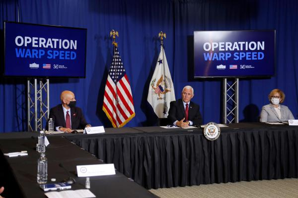 FDA Commissioner Stephen Hahn (left), Vice President Mike Pence, and Dr. Ella Grach, CEO of Wake Research, at the NC Biotechnology Center in July, where Phase 3 trials for a coronavirus vaccine candidate are underway.