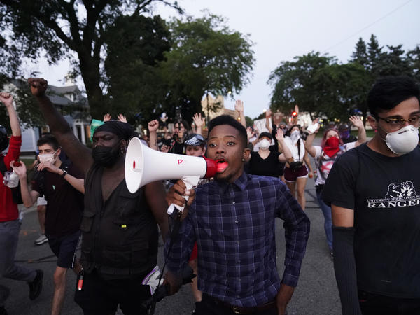 Protesters march Wednesday against the police shooting of Jacob Blake in Kenosha, Wis., over the weekend.