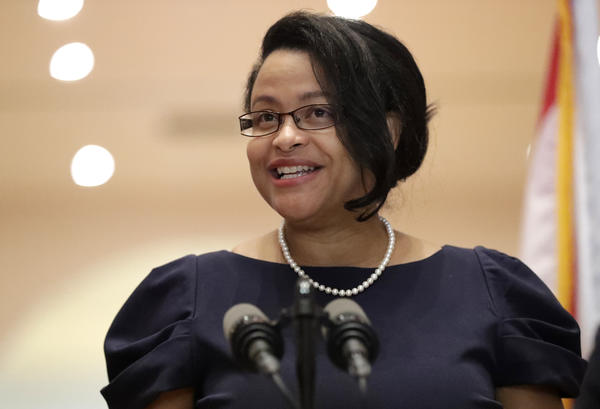 Renatha Francis smiles as she speaks during a news conference, Tuesday, May 26, 2020, at the Miami-Dade Public Library in Miami. Gov. Ron DeSantis appointed two South Floridians to the state Supreme Court on Tuesday: Francis, a Palm Beach County circuit judge who immigrated from Jamaica and, a former assistant U.S. attorney who is the son of Cuban immigrants. (AP Photo/Wilfredo Lee)