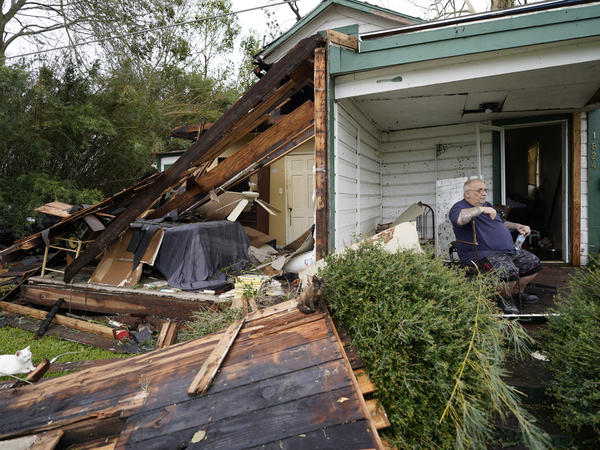 Chris Johnson views destruction at his home Thursday in Lake Charles, La., after Hurricane Laura moved through the state. Johnson stayed in his home as the storm passed.