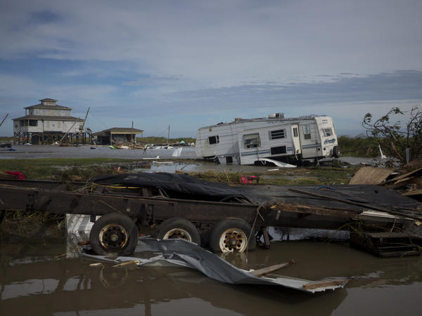 A trailer is left damaged and debris scattered Thursday in Holly Beach, La., in the aftermath of Hurricane Laura.