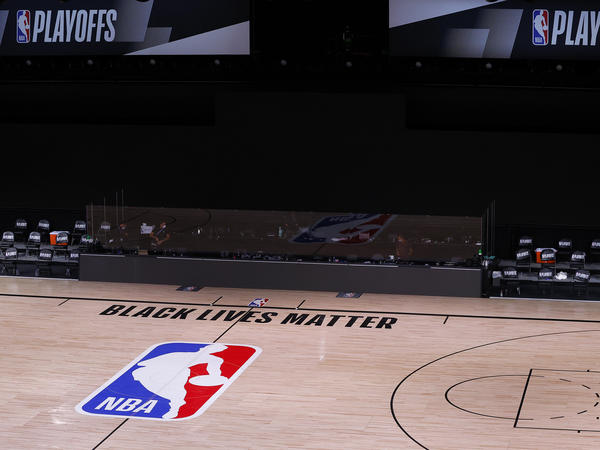 An empty court and bench are shown with no signage following the scheduled start time of Wednesday's NBA playoff series. NBA players made their strongest statement yet against racial injustice Wednesday when the Milwaukee Bucks didn't take the floor for their game against the Orlando Magic.