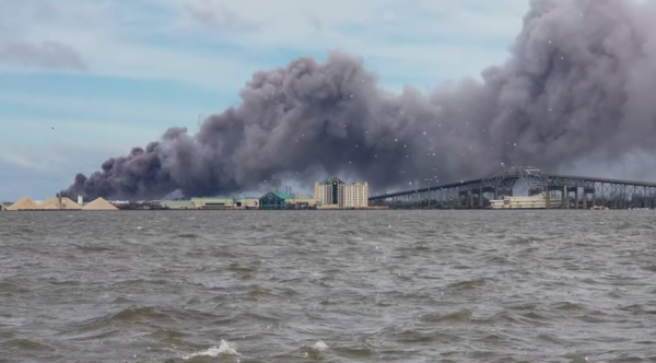 A video posted by the Cajun Navy on Facebook shows smoke rising from a fire in Westlake, Louisiana, in the aftermath of Hurricane Laura. Aug. 27, 2020.