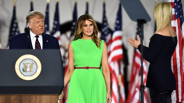 First Lady Melania Trump, center, in a bright, lime green dress at last night's Republican National Convention. It's a color begging to be photoshopped, and the Internet reliably delivered.