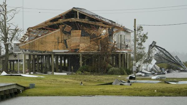 A home damaged by Hurricane Laura is seen Friday in Hackberry, La. Damage estimates from the storm range from around $4 billion to $12 billion.