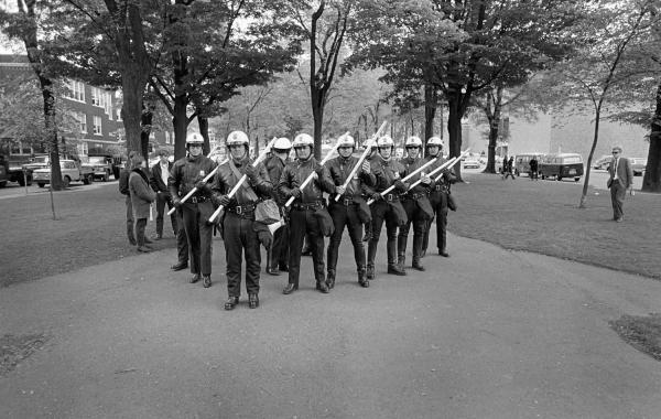 A Portland Police Bureau tactical squad marched through the South Park Blocks during 1970 Portland State University student strike.