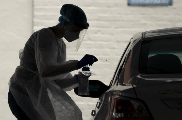 A medical professional administers a coronavirus test at a drive-thru testing site run by George Washington University Hospital, on May 26, 2020 in Washington, D.C.