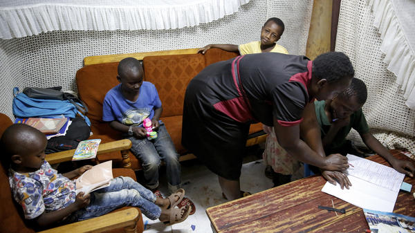 In Nairobi's Kibera slum in April, Nancy Andeka, 45, teaches her and her neighbor's children at home as schools are closed due to the coronavirus.