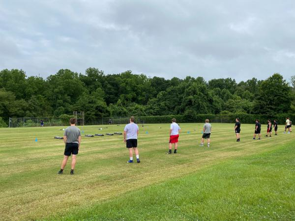 Lake Norman High School football players line up for sprints during Thursday's socially distanced practice