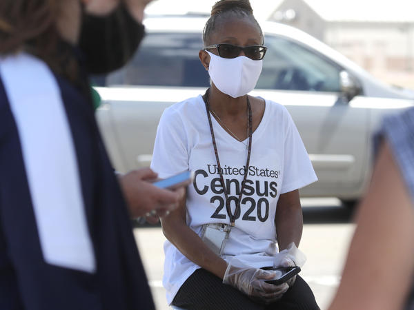 U.S. Census Bureau worker Jennifer Pope wears a face covering at a walk-up counting site in Greenville, Texas, on July 31. The bureau is ending all counting efforts for the 2020 census on Sept. 30, a month sooner than previously announced, the bureau's director confirmed Monday.