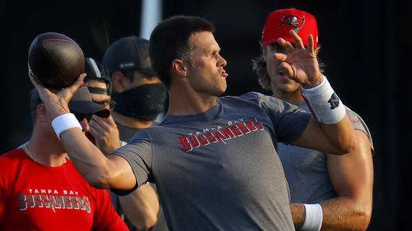 Tom Brady of the Tampa Bay Buccaneers works out in Tampa, Fla., on Tuesday. The NFL is doing daily coronavirus testing for the first two weeks of training.