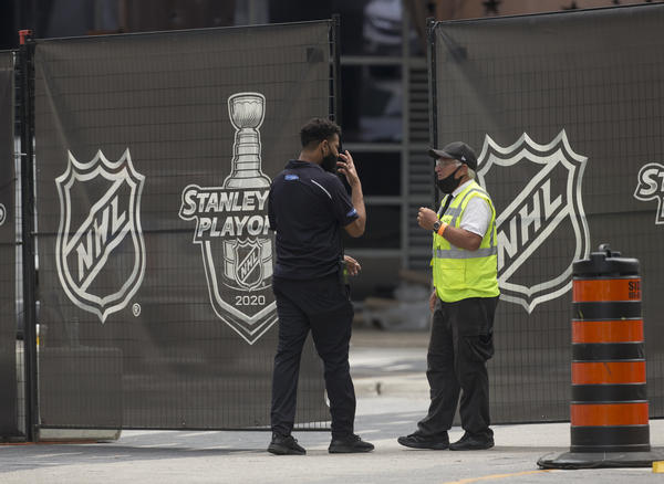 Personnel enter and exit the NHL bubble in Toronto, one of two host cities, along with Edmonton, where the league has resumed its season.