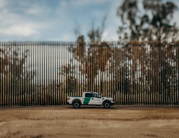 A Border Patrol truck drives along the U.S.-Mexico border.