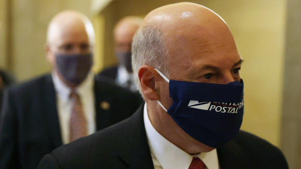 U.S. Postmaster General Louis DeJoy arrives at an Aug. 5 meeting at the office of House Speaker Nancy Pelosi.