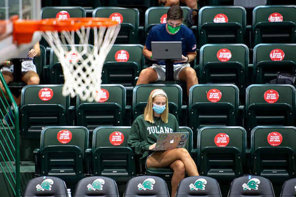 Tulane students attend class in Avron B. Fogelman Arena in the Devlin Fieldhouse.